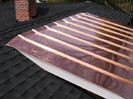 East shed dormer copper roof tb